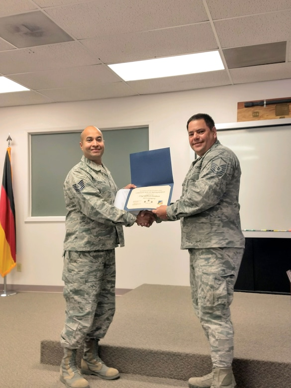 Tech. Sgt. Gilbert Cordova, 49th Force Support Squadron Airman Leadership School instructor, receives the October Top III Noncommissioned Officer Award from Master Sgt. Moises Guzman-Roman, 49th Operation Support Squadron airfield flight superintendent and Top III treasurer, Nov. 28, 2017, at Holloman Air Force Base, N.M. During the month of October, Cordova partnered with the Alamo City Hall, police department, recreation center, municipal court, public library and the clerks office. This coordination set up and judged 15 categories for 10 city of Alamogordo Halloween festivities, which was attended by 400 people. He also completed six defense acquisition university courses while instructing an ALS class and mentored 32 students from 12 different Air Force specialty codes.