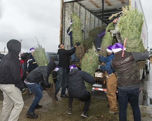 Volunteers unload Christmas trees at Joint Base San Antonio-Lackland donated by the Christmas SPIRIT Foundation, FedEx and 18 tree farmers as part of the Trees for Troops program Dec. 7, 2017.