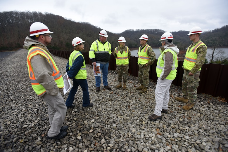 Col. Paul Kremer (Right), U.S. Army Corps of Engineers Great Lakes and Ohio River Division acting commander, visits excavation operations Dec. 5, 2017 for the installation of a roller compacted concrete berm at Center Hill Lake in Silver Point, Tenn. Nashville District leadership, project manager, and resident engineer briefed the colonel on the project. (USACE photo by Lee Roberts)