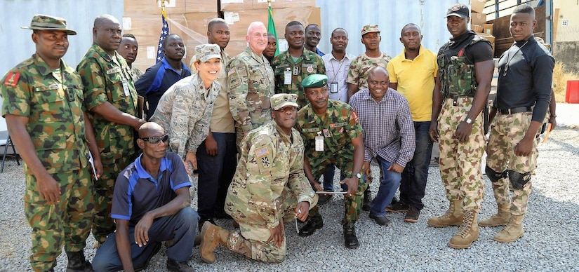 U.S. Army Africa acting commander Army Brig. Gen. Eugene J. LeBoeuf, center, poses for a group photo with U.S. service members and soldiers from the Nigerian Army in Abuja, Nigeria.