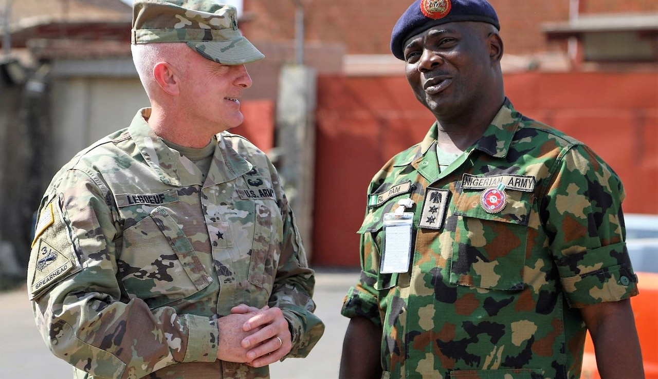 Army Brig. Gen. Eugene J. LeBoeuf, the U.S. Army Africa acting commanding general, meets with Col. R.L. Pam during an equipment handover between the U.S. Embassy to Nigeria and Nigeria army's 20th Infantry Battalion in Abuja, Nigeria.