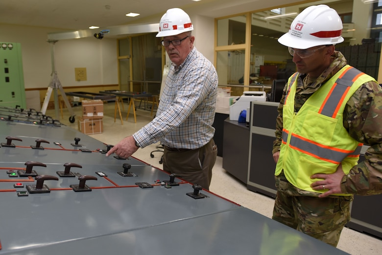 Col. Paul Kremer (Right), U.S. Army Corps of Engineers Great Lakes and Ohio River Division acting commander, gets briefed by Jeff Flowers, power plant project manager for the Nashville District's Mid-Cumberland Area, during a tour of the Center Hill Dam power plant control room Dec. 5, 2017 in Lancaster, Tenn. (USACE photo by Lee Roberts)