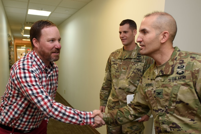 Col. Paul Kremer (Right), U.S. Army Corps of Engineers Great Lakes and Ohio River Division acting commander, meets Tavis Hanley, acting Operations Division deputy chief, during a tour of the Nashville District Headquarters in Nashville, Tenn., Dec. 6, 2017. Maj. Justin Toole (Background), Nashville District deputy commander, accompanied the colonel on the tour. (USACE photo by Lee Roberts)