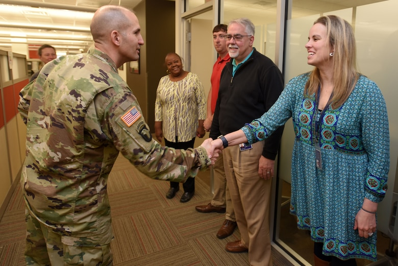 Col. Paul Kremer (Right), U.S. Army Corps of Engineers Great Lakes and Ohio River Division acting commander, meets Crystal Tingle and other members of the Natural Resources Branch during a tour of the Nashville District Headquarters in Nashville, Tenn., Dec. 6, 2017. (USACE photo by Lee Roberts)