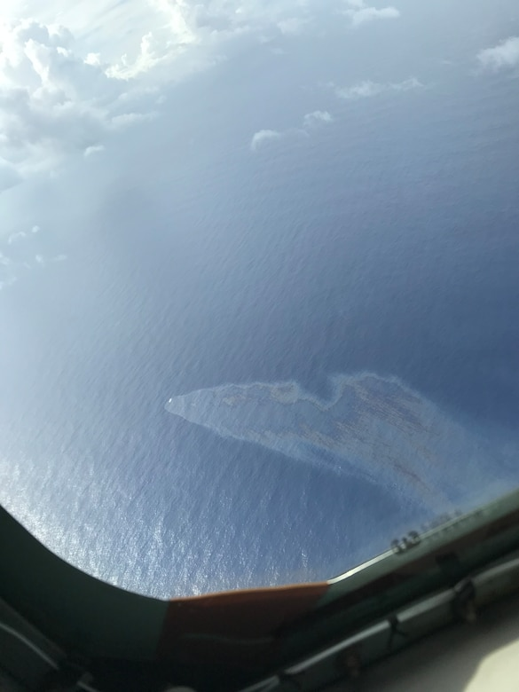 The Gyotokumaru No. 1, a civilian fishing vessel sinks 900 miles southwest of Guam as seen from a KC-135R aircraft during a search and rescue mission. The Aircraft was crewed by Pennsylvania Air National Guardsmen from the 171st Air Refueling Wing, who were deployed to Andersen AFB Nov. 21, 2017. (U.S. Air National Guard Photo)