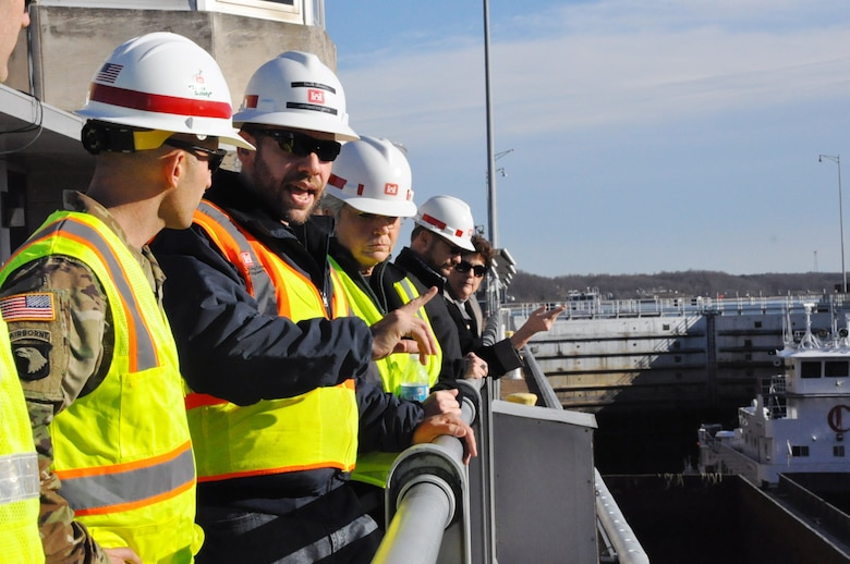 Caleb Skinner, Kentucky Lock Master, at the Kentucky Lock, describes day-to-day operations at the lock to Col. Paul Kremer, U.S. Army Corps of Engineers Great Lakes and Ohio River Division acting commander during a visit Dec. 6, 2017. (USACE photo by Mark Rankin)