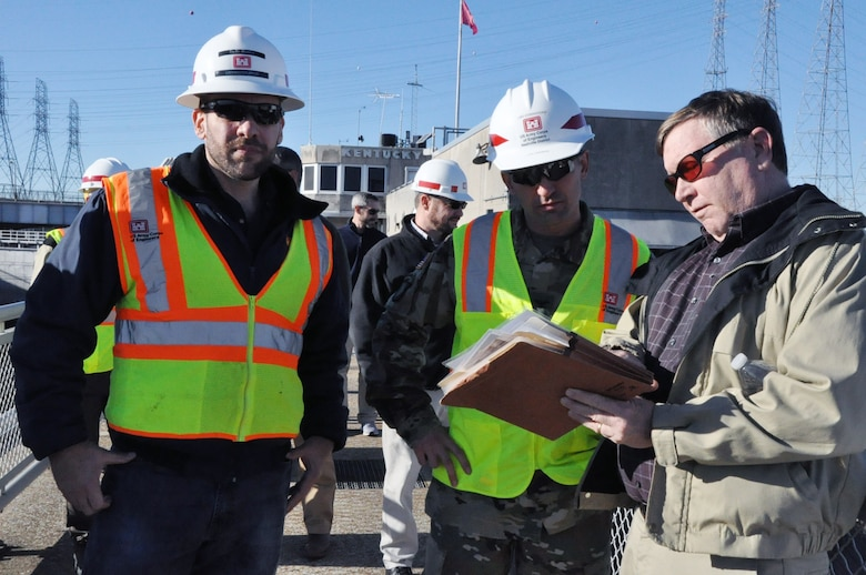 Don Getty (Right), project manager for the Kentucky Lock Addition Project, describes operations to Col. Paul Kremer (Center), U.S. Army Corps of Engineers Great Lakes and Ohio River Division acting commander, during a visit Dec. 6, 2017. Caleb Skinner, Kentucky Lock Master, at the Kentucky Lock also provided input during the tour. (USACE photo by Mark Rankin)