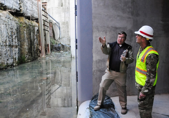 Don Getty, project manager for the Kentucky Lock Addition Project, describes lock wall and valve operations to Col. Paul Kremer, U.S. Army Corps of Engineers Great Lakes and Ohio River Division acting commander, during a visit inside the project Dec. 6, 2017 in Grand Rivers, Ky. (USACE photo by Mark Rankin)