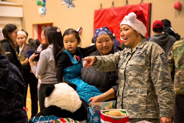 The children of St. Michael, Alaska, visit with volunteers and Alaska National Guard members during Operation Santa Claus Dec. 5, 2017. Operation Santa Claus is an Alaska National Guard annual community outreach program that provides Christmas gifts, books, back packs filled with school supplies, fresh fruit and sundaes to youngsters in rural communities.