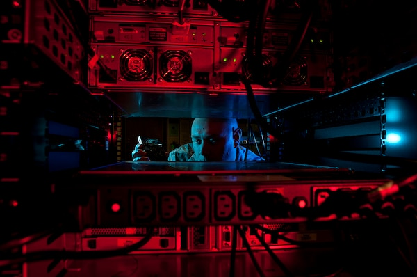 An airman prepares for a command cyber readiness