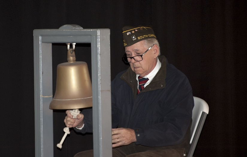 Ron Herzog, Veterans of Foreign Wars Post 10624 tolls a bell for each South Carolina resident killed during the attack on Pearl Harbor as their names are called out during the 76th Pearl Harbor Memorial Day Ceremony Dec. 7, 2017 on board the USS Yorktown at Patriots Point.