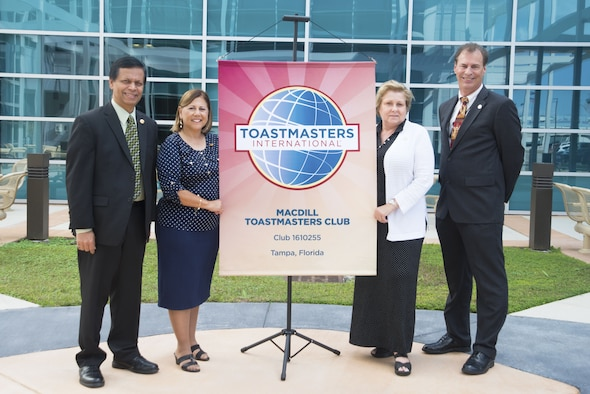 Members of Toastmasters International pause for a photo outside of Joint Special Operations University (JSOU) on MacDill Air Force Base, Fla., Nov. 29, 2017. Toastmasters International was founded by Ralph Smedley in 1924 with the purpose of improving communication, public speaking, and leadership skills of its members. (U.S. Air Force photo by Airman 1st Class Scott C. Warner)