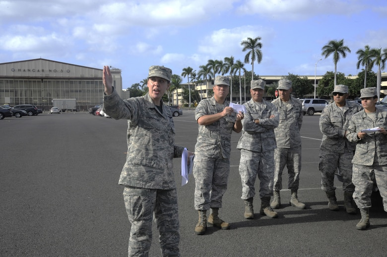 Reserve Citizen Airman Tech. Sgt. Christine Kearney-Kurt, a historian for the 624th Regional Support Group, explains the historic significance of the Base Operations building during a battlefield staff ride at Joint Base Pearl Harbor-Hickam, Hawaii, Dec. 3, 2017. The tour focused on the remnants of war from 76 years ago during the Dec. 7, 1941, attack at Hickam Field when America was launched into World War II. (U.S. Air Force photo by Master Sgt. Theanne Herrmann)