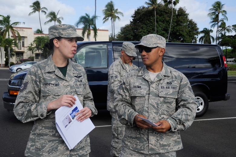 U.S. Air Force Tech. Sgt. Christine Kearney-Kurt, a historian for the Air Force Reserve 624th Regional Support Group, explains the size of the base in the 1940s compared to present day with Senior Airman Robert Coloma during a battlefield staff ride at Joint Base Pearl Harbor-Hickam, Hawaii, Dec. 3, 2017. The tour focused on the remnants of war from 76 years ago during the Dec. 7, 1941, attack at Hickam Field when America was launched into World War II. (U.S. Air Force photo by Master Sgt. Theanne Herrmann)