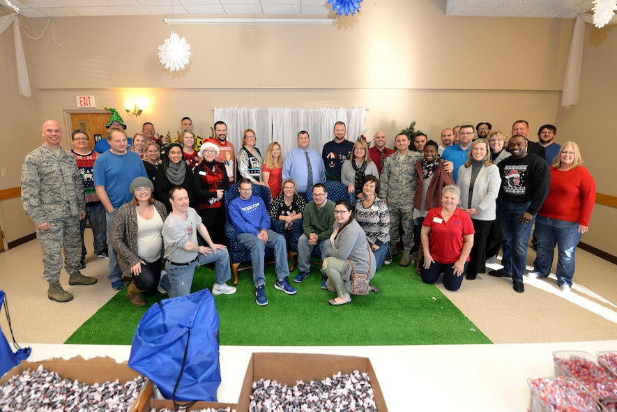 "Volunteers with ""Operation Holiday Cheer"" pose for a photo at the Bellevue Volunteer Fire Department hall in Bellevue, Neb. Dec. 5, 2017."