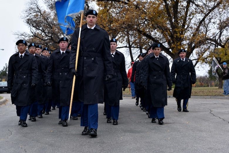 Soldiers from the 344th Military Intelligence Battalion march during the Heroes Hunt parade in San Angelo, Texas, Dec. 7, 2017. The 344th MIBN trains, develops and educates Soldiers at Goodfellow to conduct and lead signals intelligence operations.