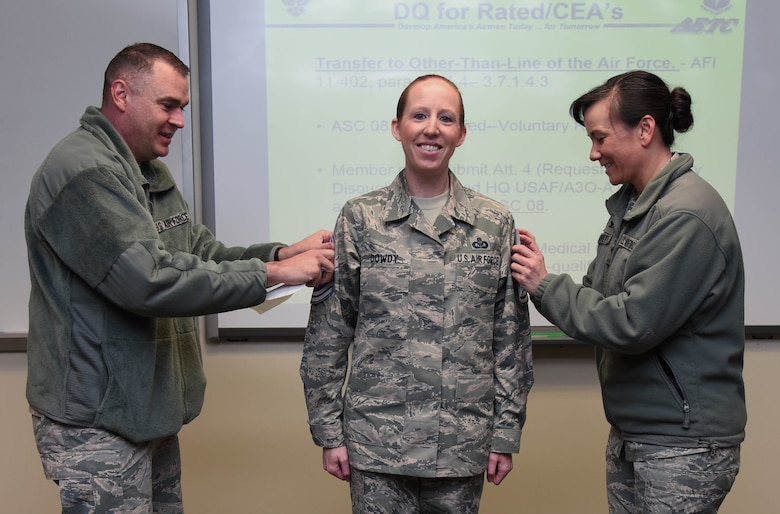 Chief Master Sgt. Leonard Trombley, 81st Training Support Squadron superintendent, and Col. Debra Lovette, 81st Training Wing commander, present Senior Master Sgt. Jessika Dowdy, 334th Training Squadron command and control training flight superintendent, with chief master sergeant stripes at Cody Hall Dec. 7, 2017, on Keesler Air Force Base, Mississippi. Keesler senior NCOs were recognized for their selection to join the top one percent of the Air Force's enlisted force. (U.S. Air Force photo by Kemberly Groue)