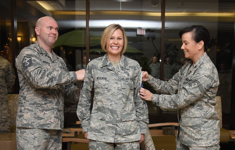 Master Sgt. William McDuffie, 81st Force Support Squadron first sergeant, and Col. Debra Lovette, 81st Training Wing commander, present Senior Master Sgt. Jacey McDuffie, 81st Diagnostic and Therapeutics Squadron pharmacy flight lead, with chief master sergeant stripes at the Keesler Medical Center Dec. 7, 2017, on Keesler Air Force Base, Mississippi. Keesler senior NCOs were recognized for their selection to join the top one percent of the Air Force's enlisted force. (U.S. Air Force photo by Kemberly Groue)