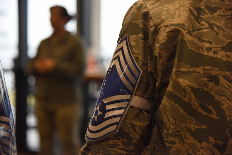 Keesler's newest chief master sergeant selects wear mock stripes during a recognition ceremony at the Bay Breeze Event Center Dec. 7, 2017, on Keesler Air Force Base, Mississippi. Keesler senior NCOs were recognized for their selection to join the top one percent of the Air Force's enlisted force. (U.S. Air Force photo by Kemberly Groue)