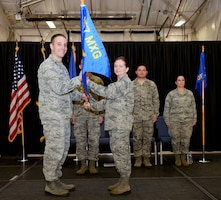 Lt. Col. Christine L. Banks receives the 157th Maintenance Group guidon from Lt. Col. Brian R. Jusseaume, the 157th MXG commander, during a change of command ceremony on December 2, 2017, at Pease Air National Guard Base, N.H. Banks assumed command of the 157th Aircraft Maintenance Squadron. (N.H. Air National Guard photo by Staff Sgt. Kayla Rorick)
