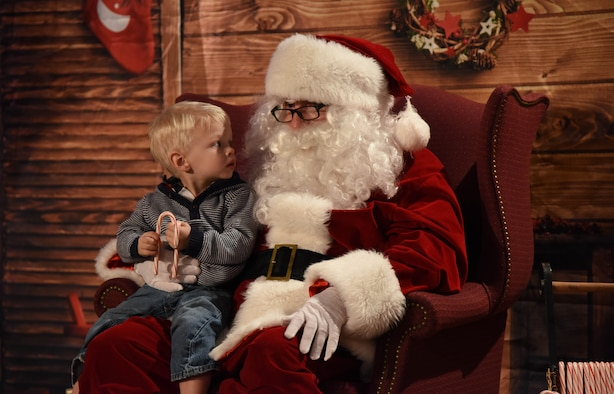 Brant Gilkison, son of Maj. Karin Gilkison, 81st Medical Operations Squadron gastroenterologist, visits with Santa during Keesler's annual Christmas celebration at the Bay Breeze Event Center Dec. 7, 2017, on Keesler Air Force Base, Mississippi. The event, hosted by Outdoor Recreation, included cookie and ornament decorating, games and visits with Santa. (U.S. Air Force photo by Kemberly Groue)