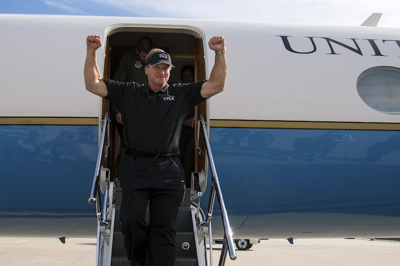 Jon Gruden, a Monday Night Football color analyst, steps out of a C-37A Gulfstream aricraft at MacDill Air Force Base, Fla., Dec. 8, 2017. Gruden toured the base after hosting a football camp for MacDill service members.