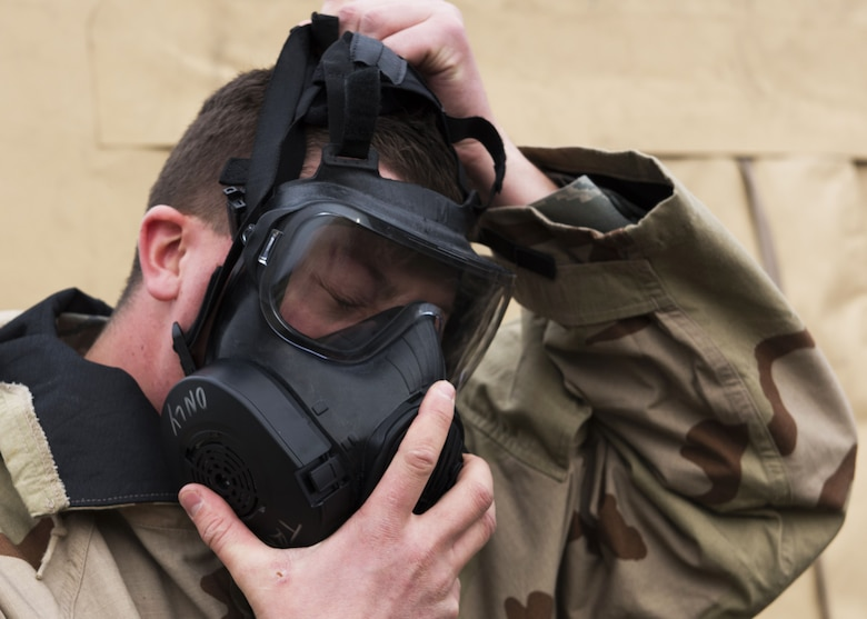 Airman 1st Class Nicholas Loew, 92nd Logistics Readiness Squadron Fuels Distribution apprentice, dons a M50 gas mask as part of an exercise at Fairchild Air Force Base, Washington, Nov. 30, 2017. The M50 gas mask is the latest generation of CBRN (Chemical, Biological, Radiological, Nuclear) protective gear. (U.S. Air Force Photo/ Senior Airman Ryan Lackey)