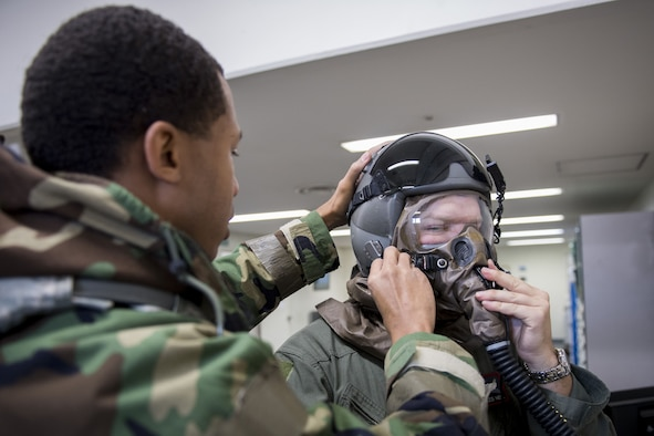Staff Sgt. Terrance Macklin, 374th Operations Support Squadron aircrew flight equipment craftsman, performs an inspection on aircrew chemical, biological, radiological and nuclear protective gear during exercise Vigilant Ace 18, Dec. 6, 2017, at Yokota Air Base, Japan.