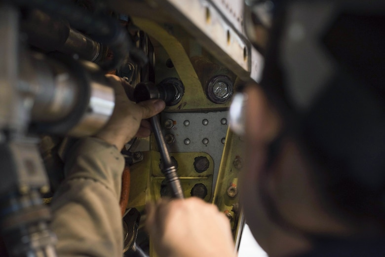U.S. Air Force Staff Sgt. Lindsay Hallford, 86th Maintenance Squadron C-130J Super Hercules crew chief, tightens the bolt on an engine component during a C-1 check on Ramstein Air Base, Germany, Dec. 5, 2017. The C1-check is a 12 day process of tearing down and rebuilding C-130J at regularly timed intervals. (U.S. Air Force photo by Senior Airman Devin M. Rumbaugh)