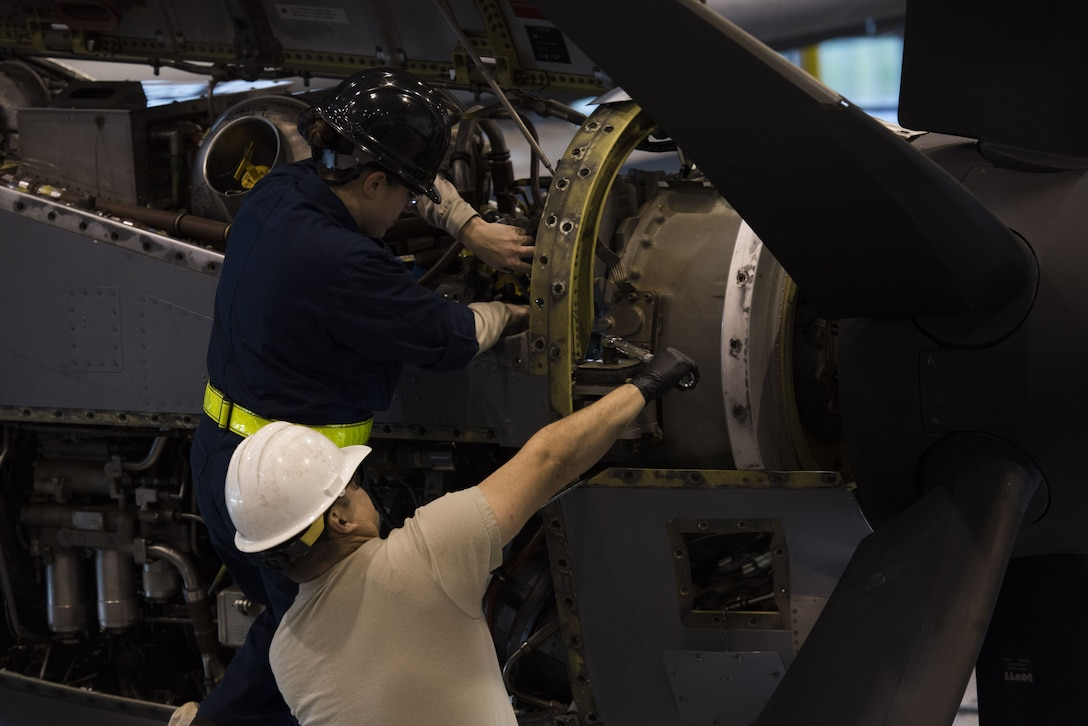 U.S. Air Force Staff Sgt. Lindsay Hallford (left), 86th Maintenance Squadron C-130J Super Hercules crew chief, and Staff Sgt. David Gilliland, 86th MXS aerospace propulsion craftsman, finish repairs on a C-130J engine during a C1-check on Ramstein Air Base, Germany, Dec. 5, 2017. Airmen from every career field in the maintenance squadron help get the aircraft airborne. (U.S. Air Force photo by Senior Airman Devin M. Rumbaugh)