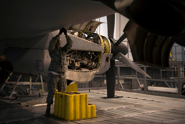 U.S. Air Force Airman 1st Class Kevin Bui, 86th Maintenance Squadron C-130J Super Hercules crew chief, places sealant on a wing tip during a C1-check on Ramstein Air Base, Germany, Dec. 5, 2017. The sealant prevents corrosion of the wings during flight. (U.S. Air Force photo by Senior Airman Devin M. Rumbaugh)