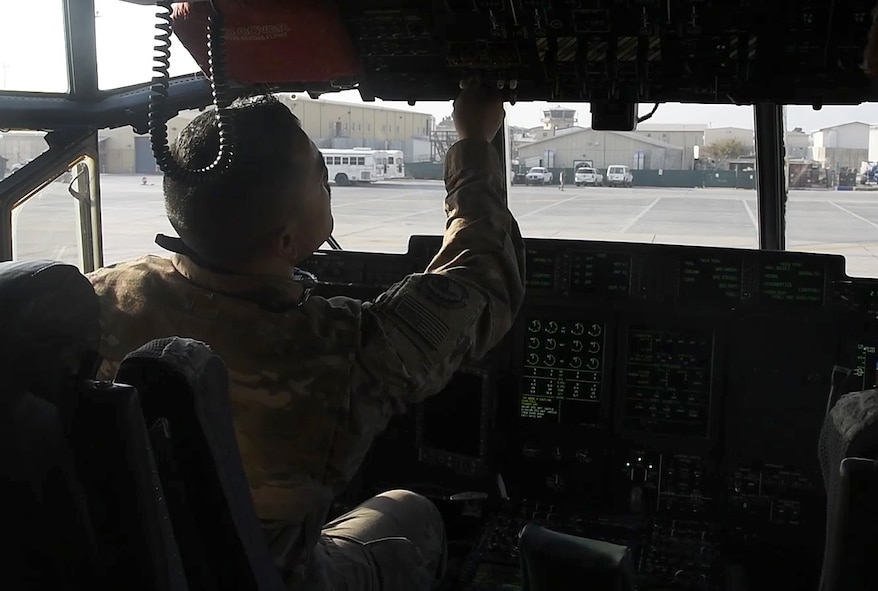 Staff Sgt. Anthony Single, 455th Expeditionary Aircraft Maintenance Squadron crew chief, resets flight controls for the pilots Dec. 5, 2017 at Bagram Airfield, Afghanistan.