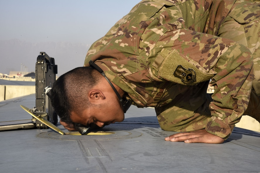 Staff Sgt. Anthony Single, 455th Expeditionary Aircraft Maintenance Squadron crew chief, inspects a C-130J Super Hercules Dec. 5, 2017 at Bagram Airfield, Afghanistan.