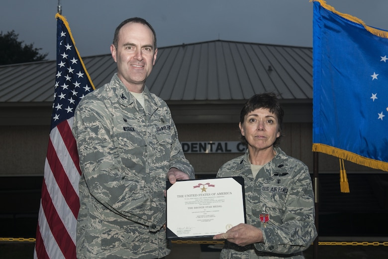 U.S. Air Force Lt. Col. Cheryl Lockhart, 20th Medical Group (MDG) chief nurse, receives a Bronze Star Medal certificate from Col. Brian Wyrick, 20th MDG commander, at Shaw Air Force Base, South Carolina, Nov. 8, 2017.