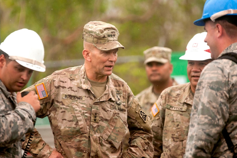 An army general speaks to a group of service members.