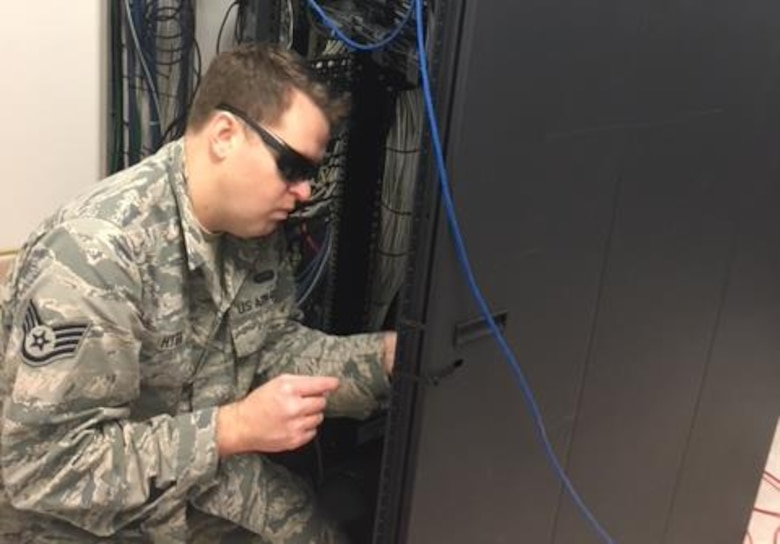 A U.S. Airman conducts upgrade work on command and control systems at Naval Station Rota, Spain, Dec. 8, 2017. Airmen assigned to U.S. Air Forces in Europe and Air Forces Africa, Air Mobility Command, Air Force Space Command, and Air Force Material command joined forces to upgrade the network. (Courtesy photo)