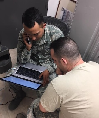 U.S. Airmen participate in a major upgrade project on command and control systems at Naval Station Rota, Dec. 8, 2017. The project involved Airmen assigned to four Air Force major commands. (Courtesy photo)