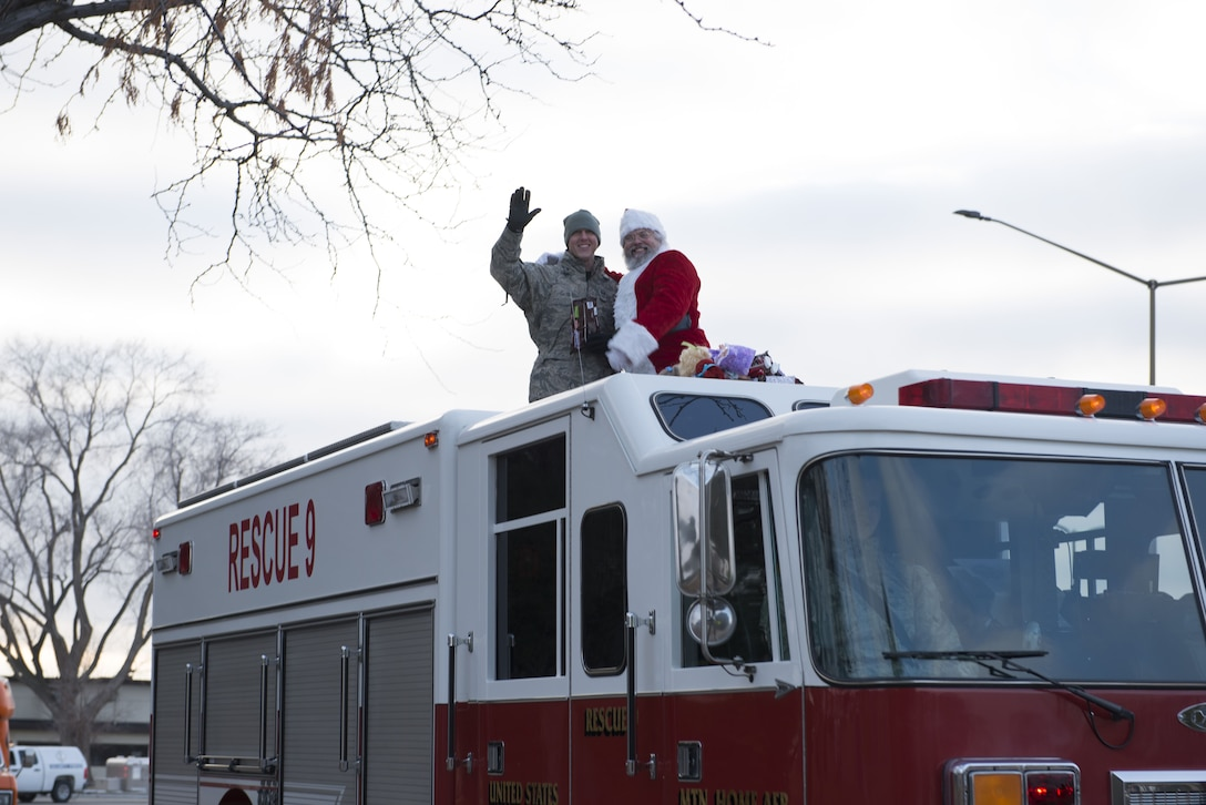 Master Sgt. Shawn Houser, 366th Equipment Maintenance Squadron first sergeant, waves and smiles with Santa during the holiday parade Dec. 8, 2017 at Mountain Home Air Force Base, Idaho. The holiday parade visited several areas around the base to include base housing, the child development center and the youth center. (U.S. Air Force photo by Senior Airman Lauren-Taylor Levin)