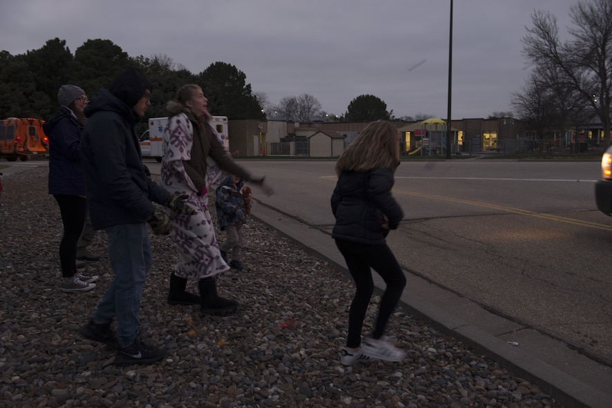 Children catch candy from float participants during the holiday parade Dec. 8, 2017, at Mountain Home Air Force Base, Idaho. The holiday parade visited several areas around the base to include base housing, the child development center and the youth center. (U.S. Air Force photo by Senior Airman Lauren-Taylor Levin)