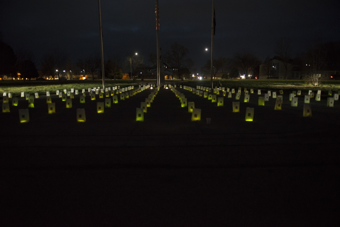Lit bags glow after Gunfighter Glow on Dec. 8, 2017 at Mountain Home Air Force Base, Idaho. The bags will stay in place during the holiday season to remember all Gunfighters who are currently deployed and away from their loved ones. (U.S. Air Force photo by Senior Airman Lauren-Taylor Levin)