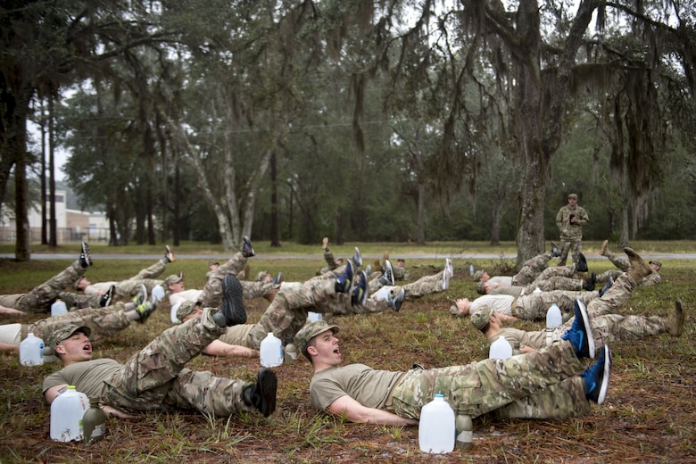Airmen from the 820th Base Defense Group perform flutter kicks during an Army Air Assault readiness assessment, Dec. 7, 2017, at Camp Blanding, Fla. The AAA readiness assessment is designed to prepare Airmen for the Army Air Assault School curriculum as well as its physical and mental stressors. During AAA, U.S. troops are taught an array of skills associated with rotary-winged aircraft. These skills widen the 820th BDG's ability to swiftly deploy and defend. (U.S. Air Force photo by Senior Airman Daniel Snider)
