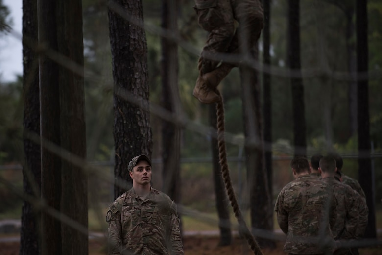 Staff Sgt. James McKinney, 823d Base Defense Squadron fireteam leader and cadre team member, watches candidates attempt an obstacle during an Army Air Assault readiness assessment, Dec. 7, 2017, at Camp Blanding, Fla. The AAA readiness assessment is designed to prepare Airmen for the Army Air Assault School curriculum as well as its physical and mental stressors. During AAA, U.S. troops are taught an array of skills associated with rotary-winged aircraft. These skills widen the 820th Base Defense Group's ability to swiftly deploy and defend. (U.S. Air Force photo by Senior Airman Daniel Snider)