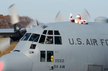 Santa Clause waves from a C-130H3 Hercules as it taxis on the runway at Dobbins Air Reserve Base, Ga. Dec. 3, 2017. Santa visited Dobbins during the December drill weekend and met with reservists and their family members to hear holiday wishes. (U.S. Air Force photo by Don Peek)