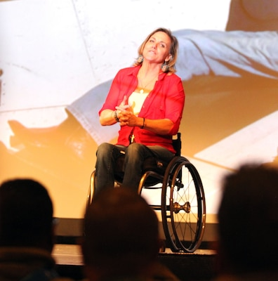 Carlana Stone, guest speaker for the Ready and Resilient campaign, addresses Soldiers and Department of Defense civilians Dec. 8 about the adversity she has faced and the resilient path she took to help herself and others at the main theater at Joint Base San Antonio-Fort Sam Houston. Stone, a paraplegic author and motivational speaker, said she enjoys speaking to service members because they are the embodiment of the resilient spirit.