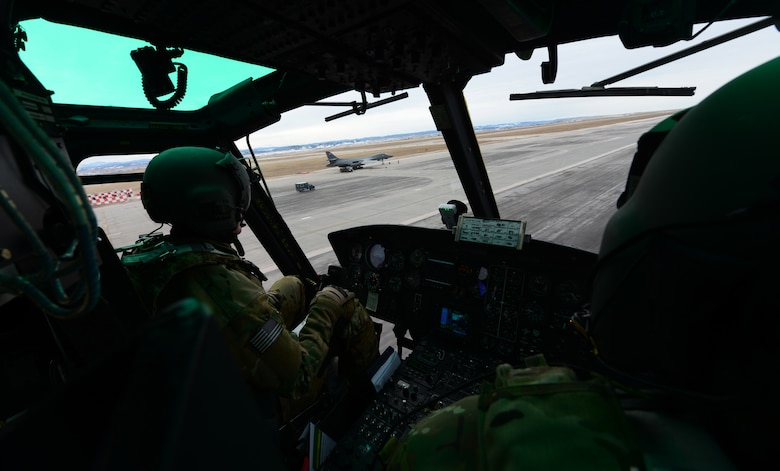The exercise was the Huey aircrew's first time training with the B-1 bomber and was designed to help prepare them for real-world situations.