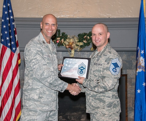 Col. Wayne Straw, Squadron Officer College commander, presents a certification of promotion to Chief Select Robert Vensel II, Air Force Reserve Officer Training superintendent, during the Maxwell Chief Select party, Dec. 7, 2017, Maxwell Air Force Base, Ala. Vensel was one of four senior master sergeants selected for the rank of chief master sergeant, the highest rank in the enlisted corps. (U.S. Air Force photo by Trey Ward)