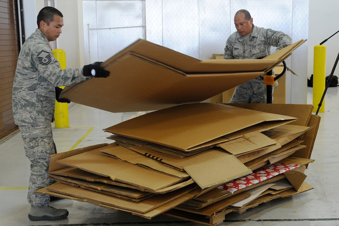 Reserve Citizen Airmen Tech. Sgt. Jesse Bamba, of Yona, Guam, and Master Sgt. Jeremiah Ignacio, of Barrigada, Guam, air transportation specialists from the 44th Aerial Port Squadron help build Christmas bundles during Operation Christmas Drop Dec. 9, 2017, at Andersen Air Force Base, Guam. Operation Christmas Drop has been providing critical supplies to 56 Micronesian Islands since 1952. The 44th Aerial Port Squadron supports the 624th Regional Support Group's mission of providing mission essential combat readiness, quality management and peacetime deployments in the Pacific area of responsibility. (U.S. Air Force photo by Staff Sgt. Daena Mansapit)