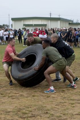 MCAS FUTENMA, OKINAWA, Japan- Marines compete in sleigh pit stop during the Annual Jingle Bell Challenge Dec. 1 on Marine Corps Air Station Futenma, Okinawa, Japan.