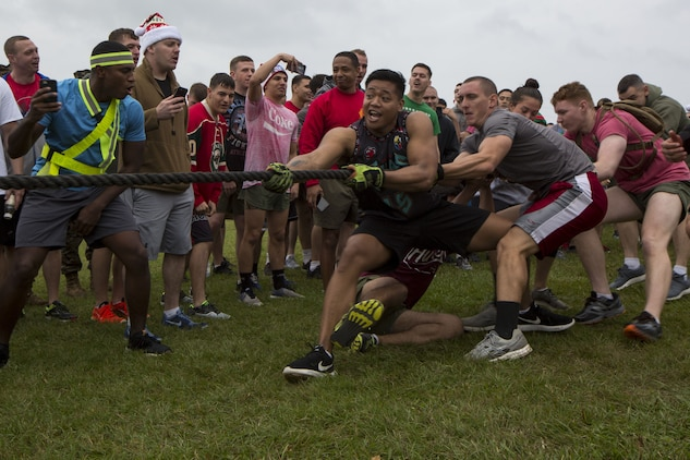 MCAS FUTENMA, OKINAWA, Japan- Marines compete in the Christmas tree workout during the Annual Jingle Bell Challenge Dec. 1 on Marine Corps Air Station Futenma, Okinawa, Japan.