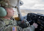 A soldier flies his small airplane to a recruiting visit